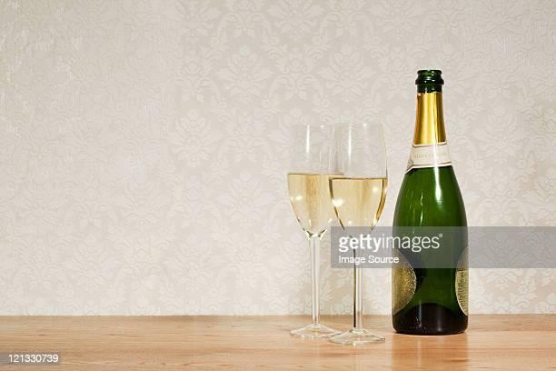 champagne bottle and two glasses - シャンパン ストックフォトと画像