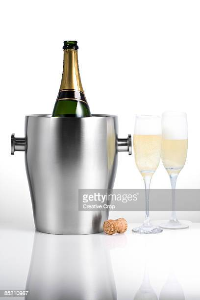 Champagne bottle, glasses and cooler bucket