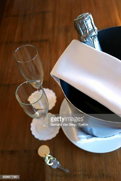 Champagne Bottle In Ice Bucket On Table