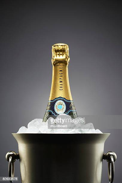 champagne bottle in ice bucket - champagne stock pictures, royalty-free photos & images