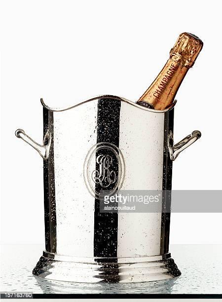 champagne bottle in wet silver bucket