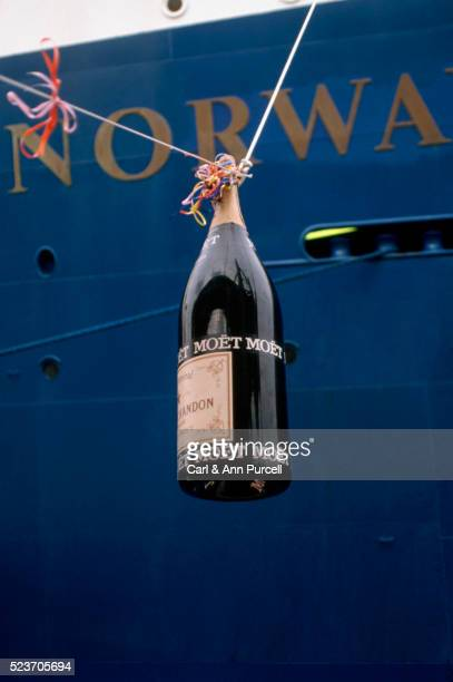 champagne bottle suspended before s.s. norway, moored in the port of miami - stapellauf stock-fotos und bilder
