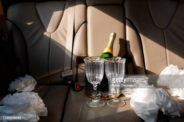 champagne bottle with glasses in back seat of car - car decoration stock pictures, royalty-free photos & images