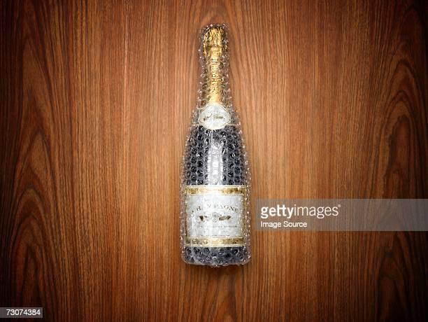 Champagne bottle wrapped in bubble wrap