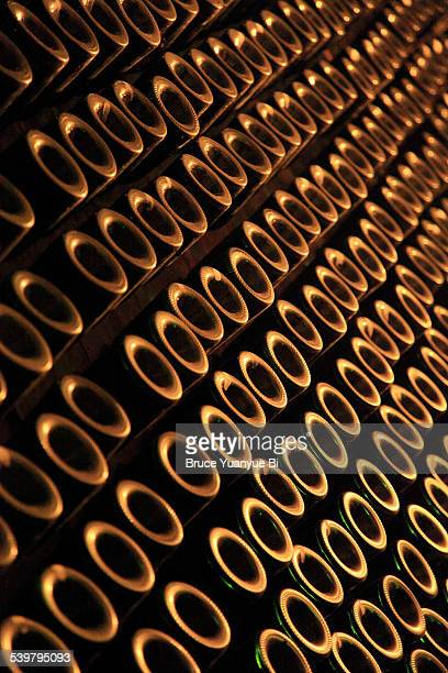 champagne bottles in a cellar - campania stock pictures, royalty-free photos & images