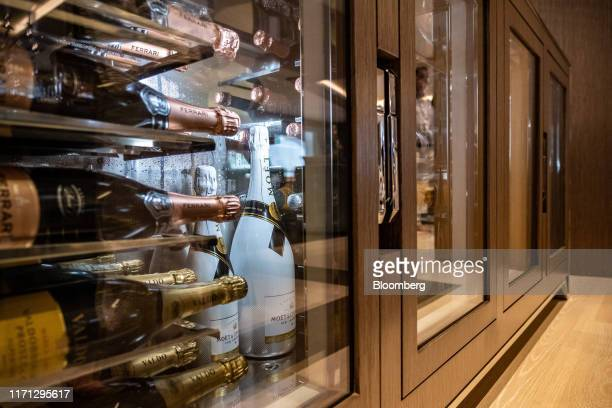 Champagne bottles sit in refrigerated cabinets on board luxury superyacht Metis manufactured by Azimut Benetti SpA during the Monaco Yacht Show in...