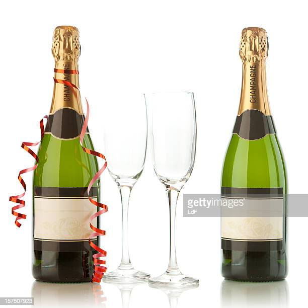 Champagne bottles with party ornaments