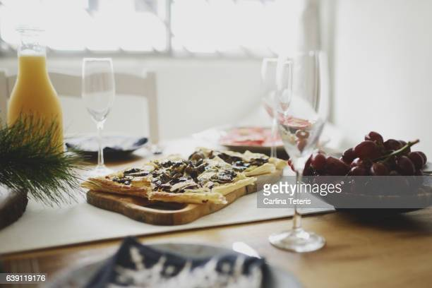 Champagne brunch table setting with a mushroom and brie tart