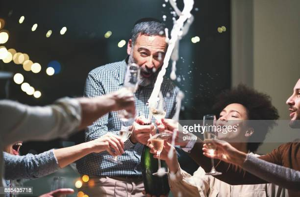 champagne celebration toast. - champagne stock pictures, royalty-free photos & images