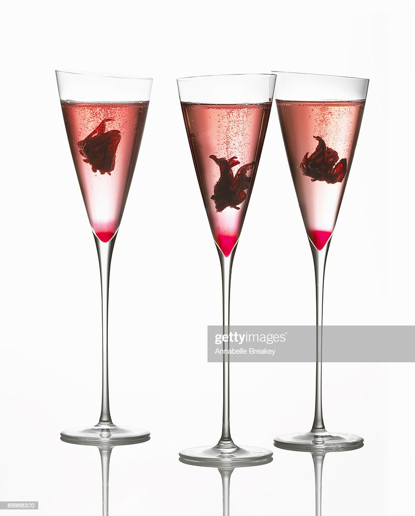 Champagne cocktail with hibiscus flowers and syrup stock photo champagne cocktail with hibiscus flowers and syrup stock photo izmirmasajfo