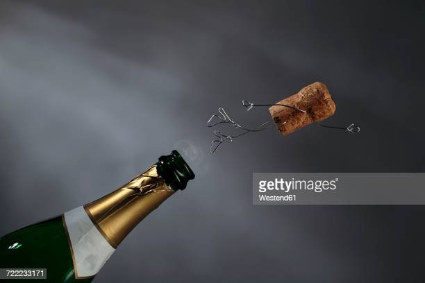 champagne cork manikin in the air - cork material stock photos and pictures