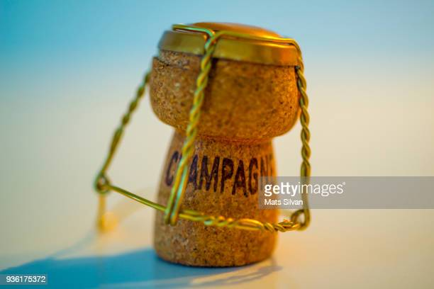 champagne cork - champagne coloured stock photos and pictures