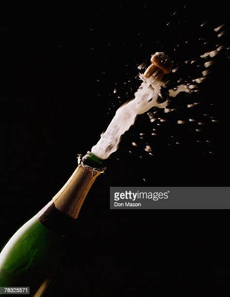 champagne cork popping - champagne cork stock photos and pictures