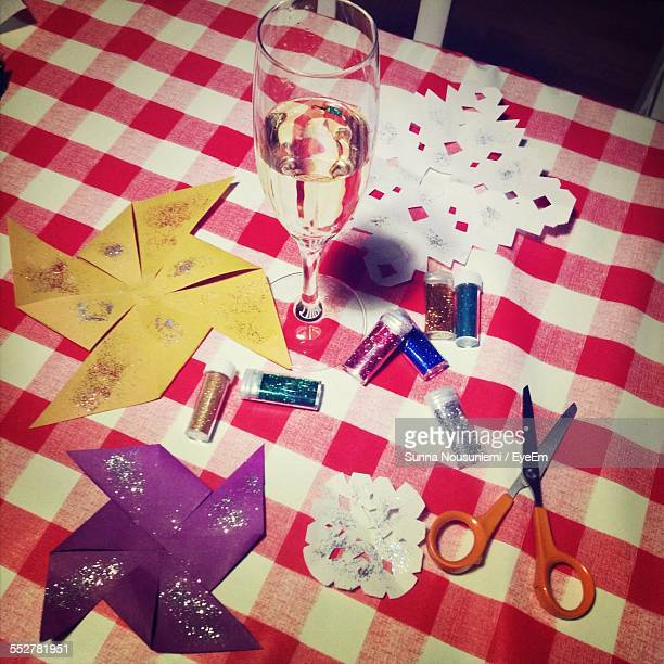 Champagne Flute Amidst Craft Material On Table