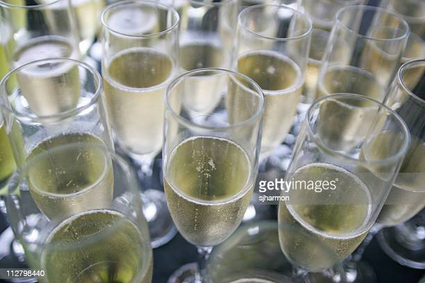 Champagne Flute Glasses filled with bubbly wine