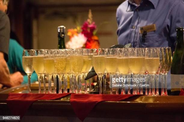 Champagne Flutes Arranged On Table During Celebration