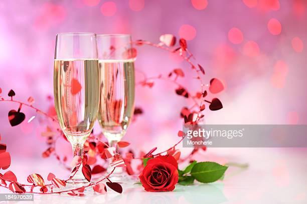 Champagne flutes on illuminated background