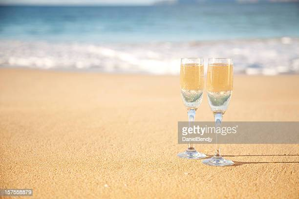 Champagne Flutes On The beach