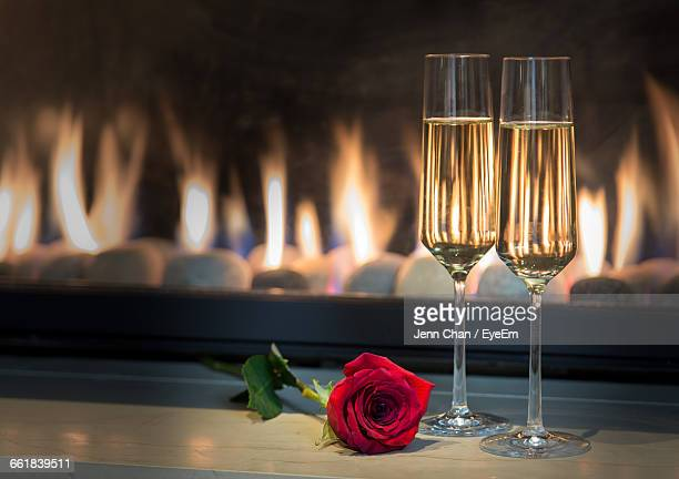 Champagne Flutes With Red Rose On Table