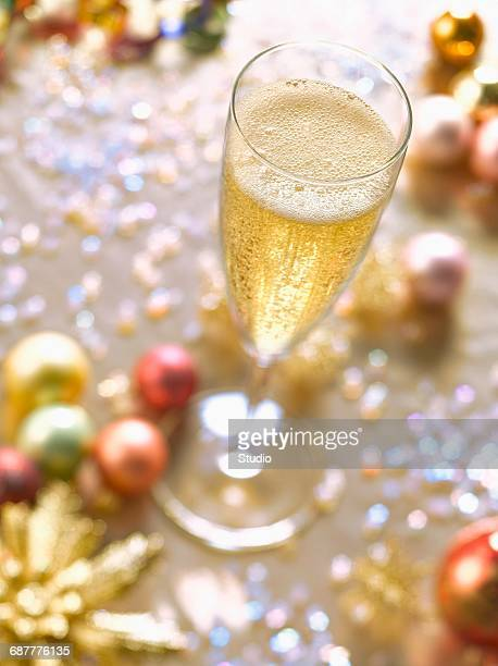 Champagne glass and Christmas decorations