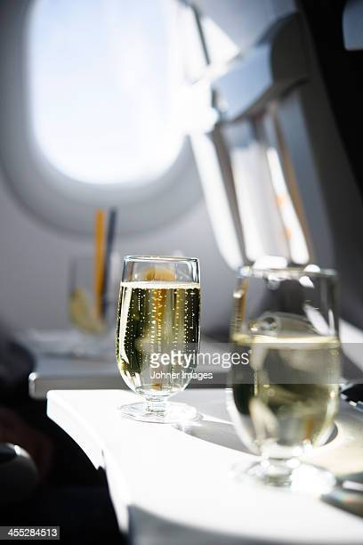 Champagne glass in airplane, close-up