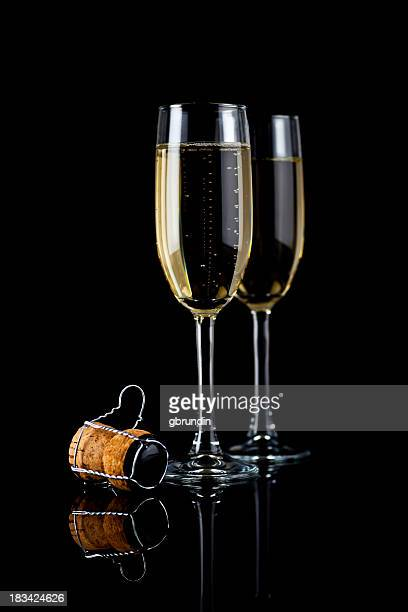 Champagne glasses and cork