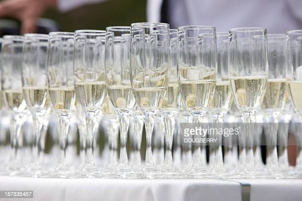 Champagne glasses being filled