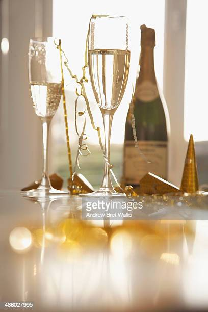 champagne glasses, streamers and hats - streamer stock photos and pictures