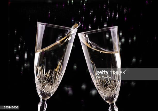 champagne glasses toast - cris cantón photography fotografías e imágenes de stock