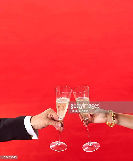 champagne glasses toasting at red carpet event - gala stock pictures, royalty-free photos & images