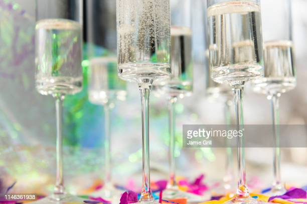 champagne glasses with confetti - champagne flute stock pictures, royalty-free photos & images