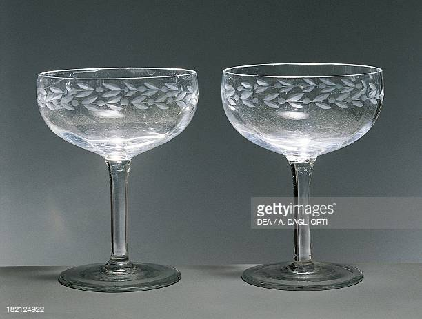 Champagne glasses with engravings around the rim 19401949 Italy 20th century