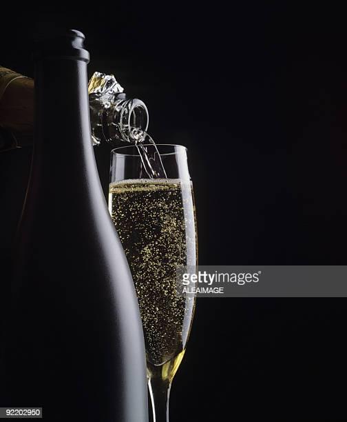 Champagne in black copy space