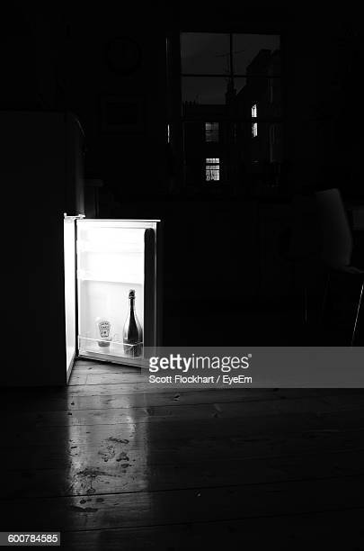 Champagne In Illuminated Refrigerator