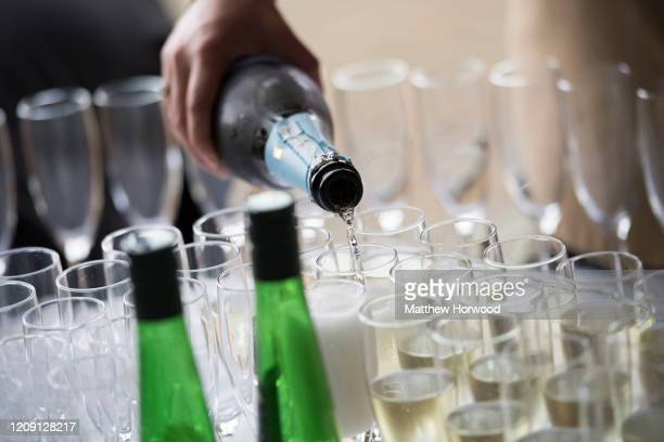 Champagne is poured into glasses on June 16, 2016 in Cardiff, United Kingdom. A new law setting a minimum alcohol price came into force on March 2...