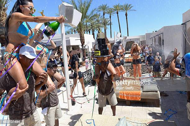 Champagne is sprayed as a cake is presented to the BKB Knockout Girls during the inaugural fight celebration at Daylight Beach Club at the Mandalay...