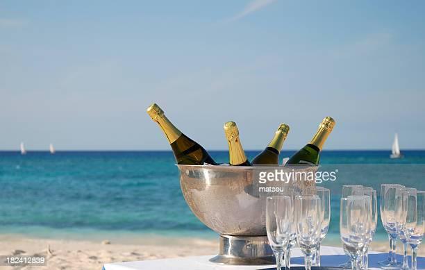 Champagne on beach.