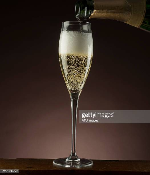 Champagne poured from bottle