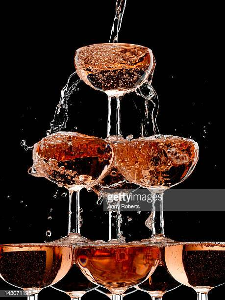 https://media.gettyimages.com/photos/champagne-pouring-into-stacked-glasses-picture-id143071195?s=612x612