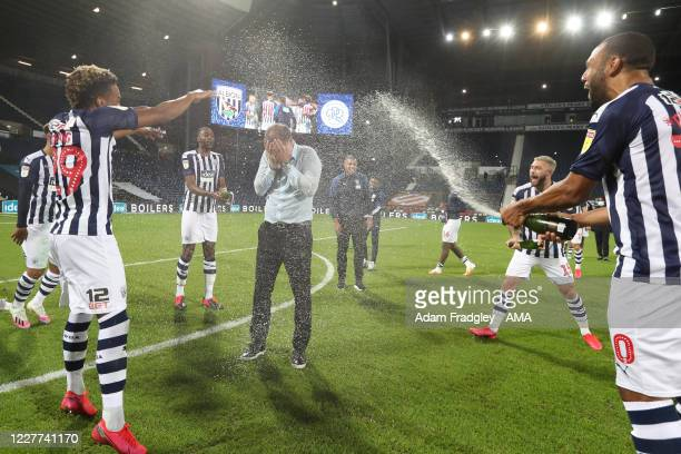 Champagne soaked Slaven Bilic head coach / manager of West Bromwich Albion as the team celebrate promotion to the Premier League on the pitch at the...