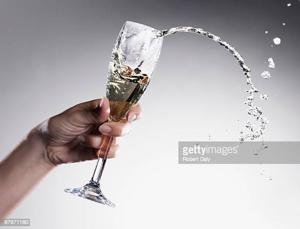 Champagne spilling from glass