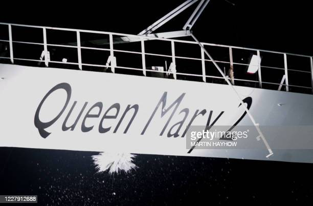 Champagne splashes down the side of the Queen Mary 2 Cruise liner at Southampton, 08 January 2004, during the naming ceremony by Britain's Queen...