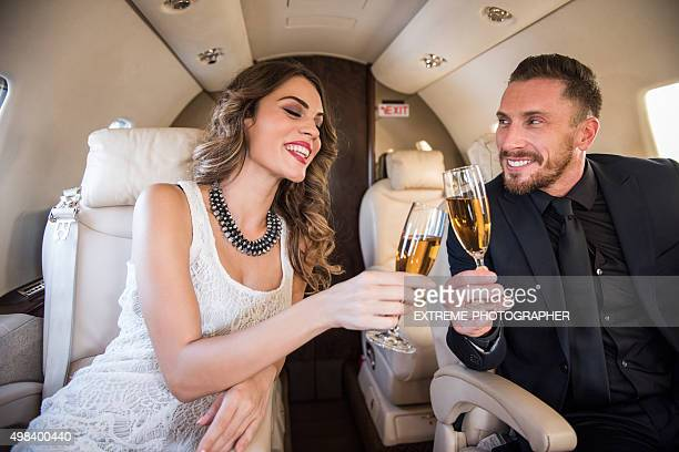 Champagne toast in private jet airplane