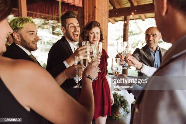 champagne toasting celebration at the gay wedding - wedding party stock pictures, royalty-free photos & images