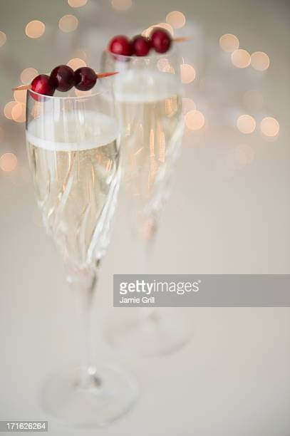 Champagne with cranberry garnish