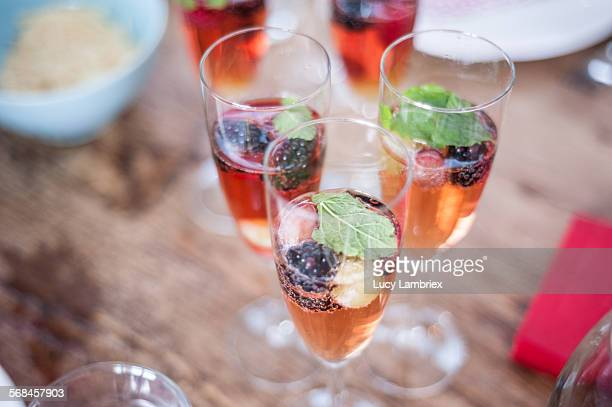 Champaign glasses with pink cava and fruit