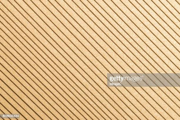champaign gold colored paper stacking - champagne coloured stock photos and pictures