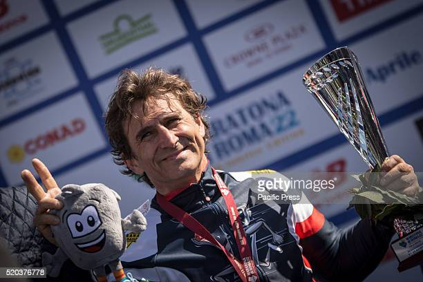 Champion Alex Zanardi first with the course record for the fifth time during awarding of Rome Marathon 2016 The winners of the marathon in Rome 2016...