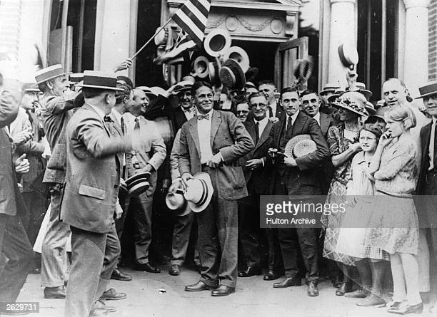 Champion American golfer Bobby Jones who won the British Open three times and the US Open four times is greeted by a crowd at a Southern Railway...