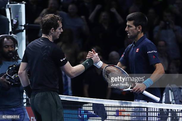 Champion Andy Murray of Great Britain is congratulated by Novak Djokovic of Serbia following the Singles Final against Novak Djokovic of Serbia at...